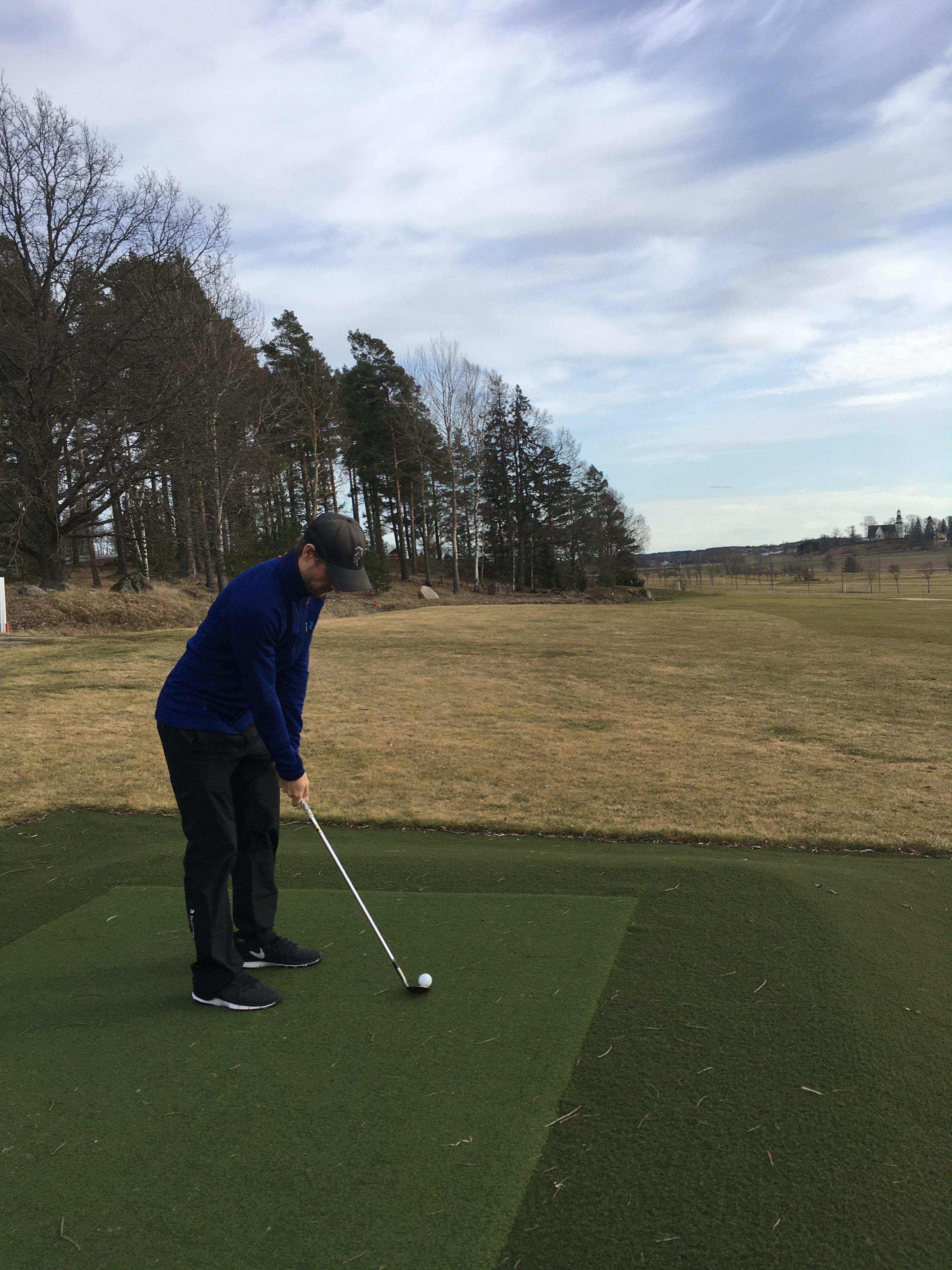 Person på golfrange