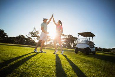 Glada golfspelare